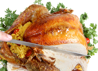 Carving a roast turkey for christmas or thanksgiving