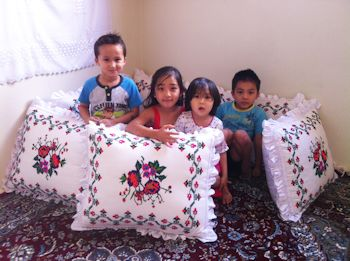 kids and cushions