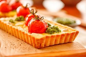 Tomato onion and goats cheese tart with macadamia pesto and crust (landscape)