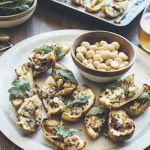 Recipe: Roasted potato skins with macadamias, bacon, rocket and blue cheese
